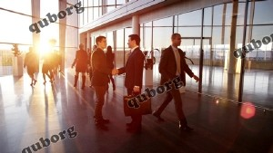 Motion Graphic - Two Young Businessmen Shake Hands